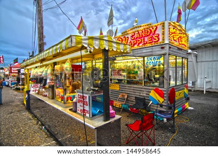 Fair Corn Dogs, part of the midway at state fair - stock photo