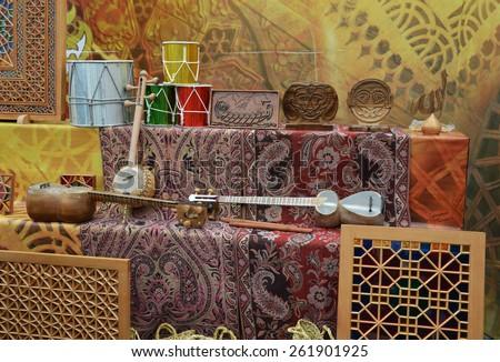 Fair dedicated to the celebration of Novruz holiday, Baku, Azerbaijan. National dishes, musical instruments and various souvenirs - stock photo