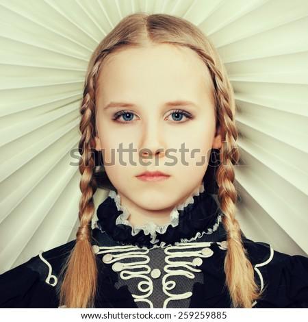 Fair hair girl with fashion hairstyle - stock photo