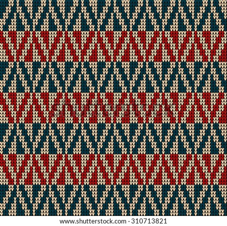 Fair Pattern sweater design on the wool knitted texture. Red and blue Knitting Ornament - stock photo