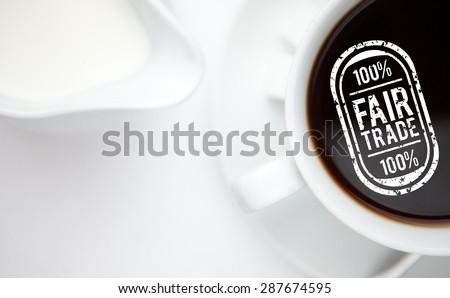 Fair Trade graphic against espresso - stock photo