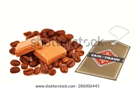 Fair Trade graphic against two pieces of chocolate on coffee seeds - stock photo