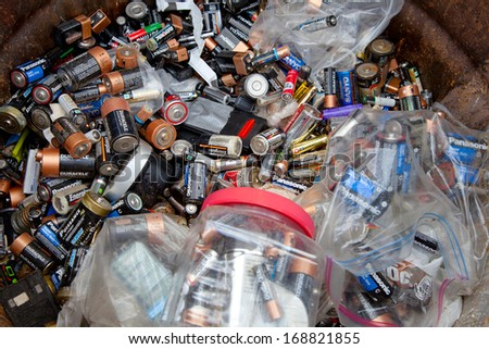 FAIRFAX, VA - DECEMBER 5: A load of used batteries lying in a recycling facility on December 5, 2013 in Fairfax, VA. The acid will be neutralized and polymers will be separated from the lead. - stock photo