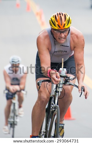 FAIRFAX, VA - JULY 3: A cyclist competes in the triathlon at the World Police & Fire Games on July 3, 2015 - stock photo