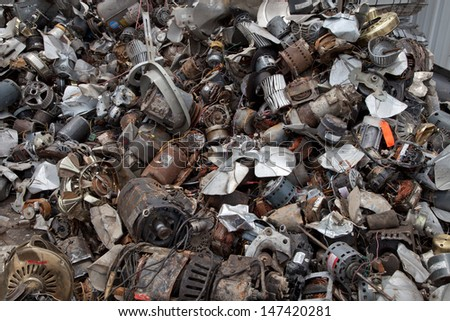 FAIRFAX, VA - JULY 24: A pile of electric engines lying in a recycling facility on July 24, 2013 in Fairfax, VA. They will be dismantled and metal will be separated by type. - stock photo