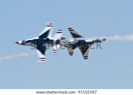 FAIRFIELD, CA - JULY 30: USAF Thunderbirds fly F-16 Fighting Falcon show precision and the highest level of pilot skills during an Airshow on July 30, 2011 at Travis Air Force Base, near Fairfield, CA - stock photo
