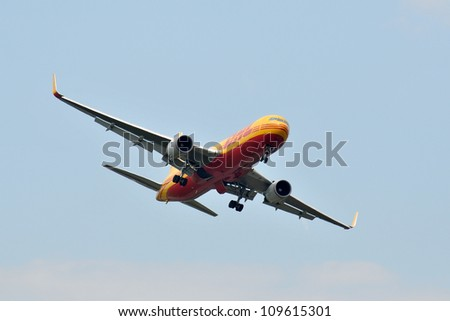 FAIRFORD, UK - JULY 8: DHL 767 aircraft participates in the Royal International Air Tattoo airshow event July 8, 2012 near Cirencester, England. - stock photo