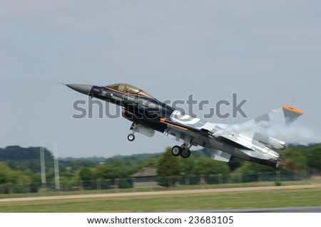 FAIRFORD, UK - JULY 16, 2005: Dutch F-16 in a special paint scheme takes off during an air demonstration at the Royal International Air Tattoo on July 16, 2005 in Fairford, UK.