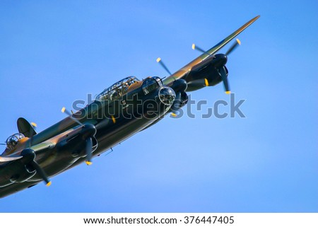 FAIRFORD, UK - JULY 16, 2006: Lancaster bomber aircraft performs at the Royal international air tattoo in Fairford, Gloucestershire, England.