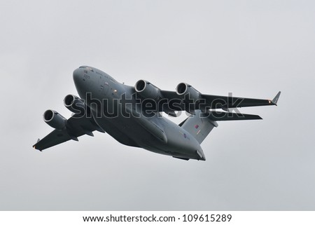 FAIRFORD, UK - JULY 8: Royal Air Force C-17 Globemaster Transport aircraft participates in the Royal International Air Tattoo airshow event July 8, 2009 near Cirencester, England. - stock photo