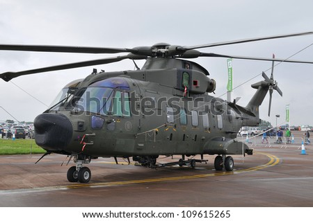 FAIRFORD, UK - JULY 8: Royal Air Force Merlin Helicopter participates in the Royal International Air Tattoo airshow event July 8, 2012 near Cirencester, England. - stock photo