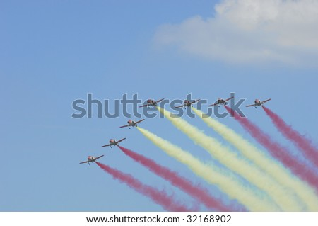 FAIRFORD, UK - JULY 16: Spanish Patrulla Ãguila perform a 8 ship multi smoke flypast climb during a display at the Royal International Air Tattoo on July 16, 2005 in Fairford, UK.