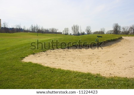 Fairway of golf course with sand traps - stock photo