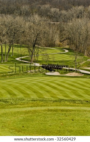 Fairway view of a golf course scene in early spring. - stock photo