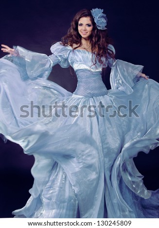 Fairy. Beautiful Girl in Blowing Dress Flying. - stock photo