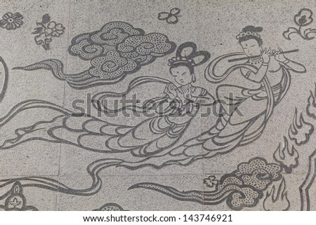 Fairy carved on stone wall in chinese temple Thailand - stock photo