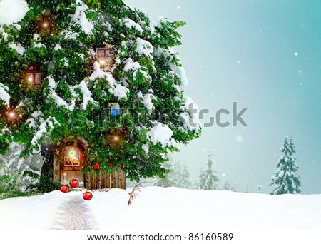 Fairy cottage in a Christmas ornament with a snowy landscape