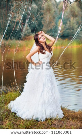 fairy fashion young bride on the nature - stock photo