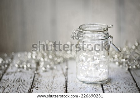 Fairy lights in a jar - stock photo