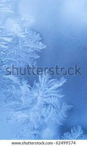 Fairy-like sparkling winter background (slightly blurred frostwork on a window glass) - stock photo