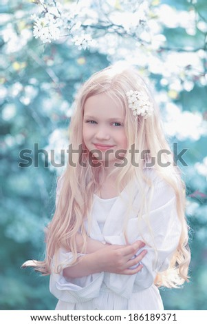 Fairy portrait young girl teen in white. Spring day, blooming cherry tree - stock photo