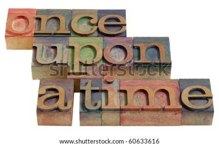 fairy story narration (opening phrase) - words in vintage wooden letterpress printing blocks, isolated on white - stock photo