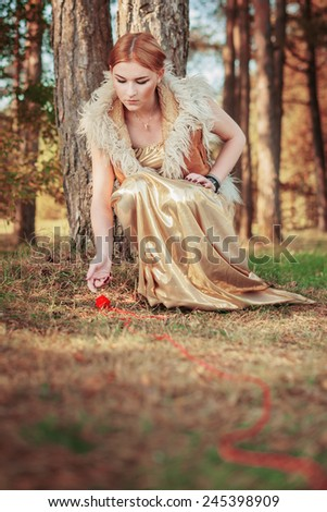 fairy tale about princess with fatal ball of threads in the wood - stock photo