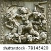 "fairy tale ""RAMAYANA"" stucco native Thai style on wall of Buddhist church at Wat Panan Choeng Ayutthaya province Thailand - stock photo"