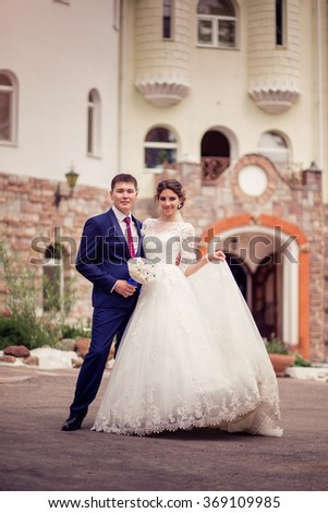 Fairy-tale wedding couple. bride and groom on the background of the hotel or castle