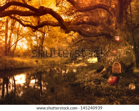 Fairy tale with elf house and pumpkin,rabbit and lights in the forest,fantasy picture - stock photo