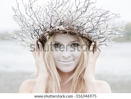 Fairy woman in brench wreth - stock photo