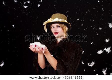 Fairy woman in feathers rain  - stock photo