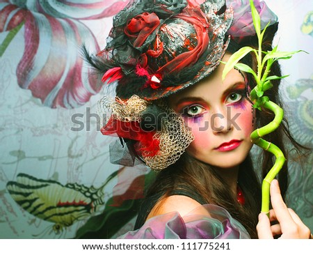 Fairy. Young woman in creative image with bamboo - stock photo