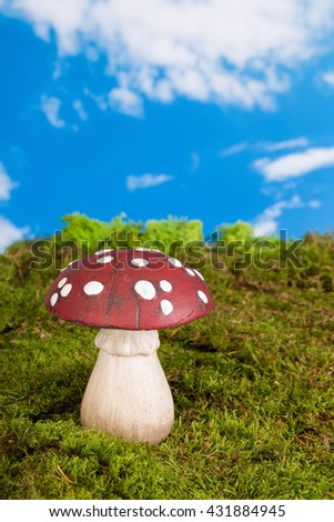 Fairytale background with agaric toadstools and moss - stock photo