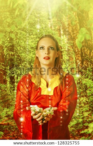 Fairytale. Young beautiful woman fairy in summer magic forest - stock photo