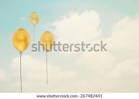 Faith, hope, love texts on gold color baloons with sky and clouds background in vintage style on paper texture  : Religious doctrine on golden egg ballons : Heavenly Christine virtues concept  - stock photo