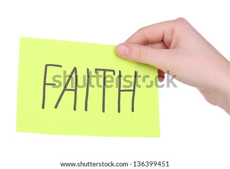Faith word on piece paper in hand isolated on white