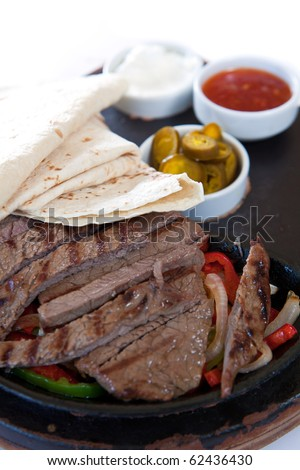 Fajita with marinated steaks and sauces - stock photo