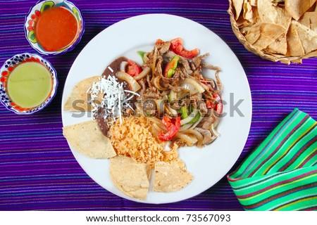 Fajitas de res beef fajita Mexican food nachos and chili sauce - stock photo