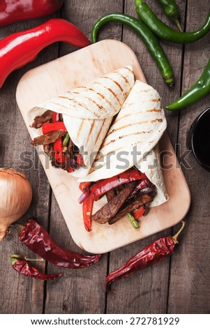 Fajitas, mexican beef with grilled vegetable in tortilla wraps - stock photo