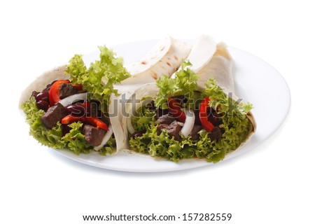 Fajitas on a plate isolated on white background - stock photo