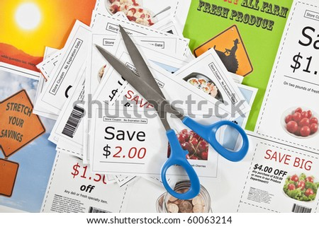 Fake coupons on a fake coupon background.  All images were taken by the photographer.  The text is fictional.  The bar codes are made up.  No actual ads were used. - stock photo
