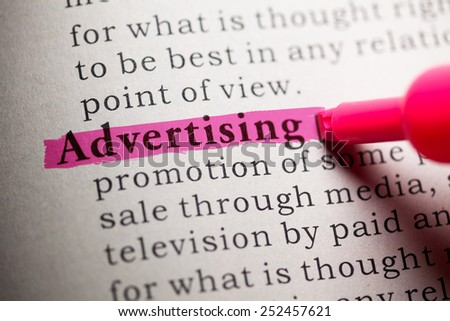 Fake Dictionary, definition of the word advertising. - stock photo