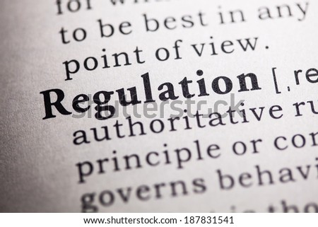 Fake Dictionary, Dictionary definition of the word regulation. - stock photo