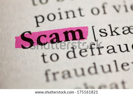 Fake Dictionary, Dictionary definition of the word Scam. - stock photo