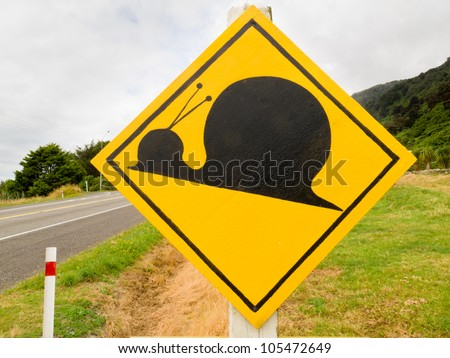 Fake New Zealand Road Sign, Attention Kauri Snail Crossing set up a rural country road - stock photo
