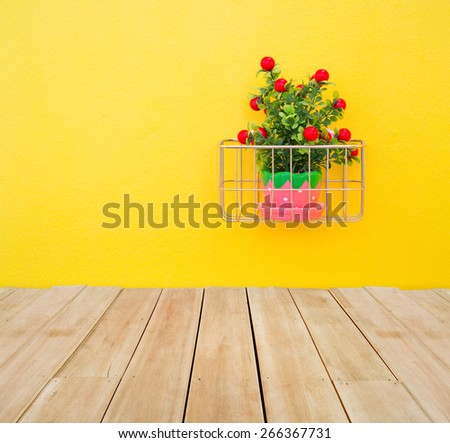 Fake ornamental plants with concrete wall and wood floor. - stock photo