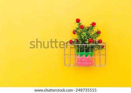 Fake ornamental plants with concrete wall background. - stock photo