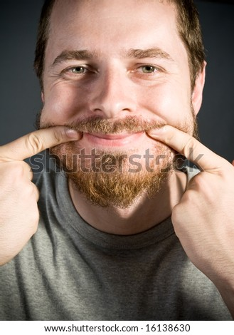 Fake Smile and Facial Expressions Concept - stock photo