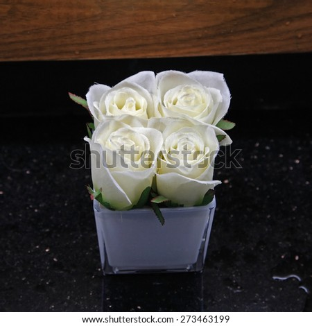 Fake White roses in aluminum pot decorated in toilet - stock photo